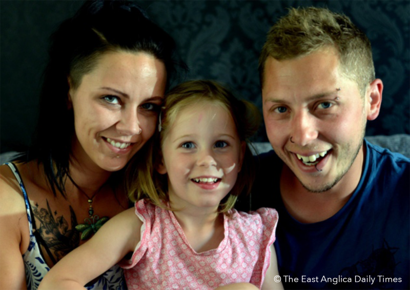 Mother and Father smiling with epileptic daughter