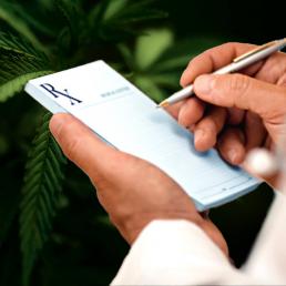 Doctor writing out a prescription for medical marijuana