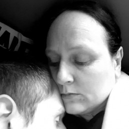 Black and white photo of British mother holding her epileptic son
